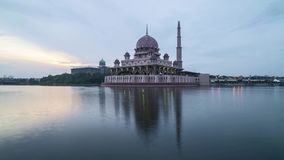 Sunrise at Putrjaya Mosque. Time lapse 4k Footage of Beautiful Dramatic sunrise At Putrajaya Mosque with reflection on the water. Pan right stock video
