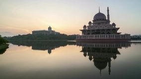 Sunrise At Putrajaya Mosque with reflection. Time lapse 4k Footage of Beautiful Dramatic Sunrise At Putrajaya Mosque with reflection on the water. Tilt down stock video