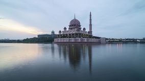 Sunrise at Putrjaya Mosque. Time lapse 4k Footage of Beautiful Dramatic sunrise At Putrajaya Mosque with reflection on the water. Tilt down stock video