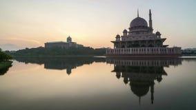 Sunrise At Putrajaya Mosque with reflection. Time lapse 4k Footage of Beautiful Dramatic Sunrise At Putrajaya Mosque with reflection on the water. Tilt up stock video footage