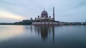 Sunrise at Putrjaya Mosque. Time lapse 4k Footage of Beautiful Dramatic sunrise At Putrajaya Mosque with reflection on the water. Zoom out stock video