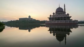 Sunrise At Putrajaya Mosque with reflection. Time lapse 4k Footage of Beautiful Dramatic Sunrise At Putrajaya Mosque with reflection on the water. Zoom out stock video