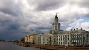Time lapse Kunstkamera museum and University embankment. Cityscape view of Saint Petersburg, Russia. Dramatic thunderclouds stock footage