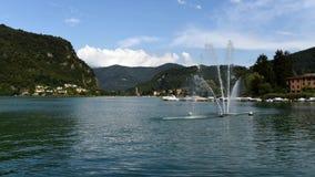 Time Lapse of lake Ceresio with fountain in Lavena Ponte Tresa, Italy stock footage