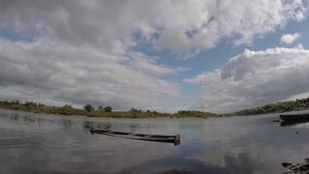 A Time Lapse on the lake with a sunken boat. The clouds are moving stock video footage
