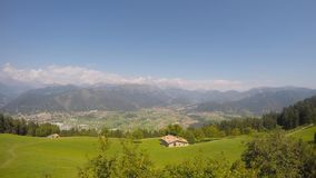 Time lapse landscape on the city of Clusone from the mountain lodge called San Lucio. In summer time stock video footage