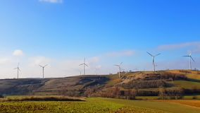 Time- lapse. Landscape with a working wind turbines in field . Concept of ecologic lifestyle stock video