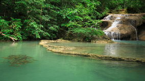 Time-lapse of Level 1 of Erawan Waterfall with Neolissochilus stracheyi fish in Kanchanaburi Province, Thailand stock video