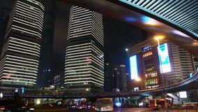 Time lapse light trails of cars under overpass & skyscraper,shanghai,china. Time lapse shanghai night traffic & skyscraper,light trails of cars under overpass stock video