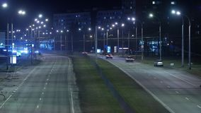 Time lapse, the light trails of city traffic on the building background. stock footage