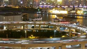 Time lapse,the light trails of urban traffic on overpass,shipping on river. Freeway busy city rush hour heavy traffic jam highway Shanghai at night,the light stock video
