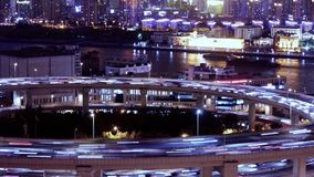 Time lapse,the light trails of urban traffic on overpass,shipping on river. stock video footage