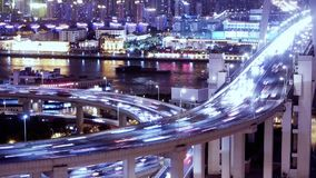 Time lapse,the light trails of urban traffic on overpass,shipping on river. stock video