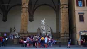 Time lapse of Loggia dei Lanzi, Florence. Florence, October 2017: Time lapse of tourists in front of the statue of the Rat of the Sabine inside the Loggia dei stock video footage