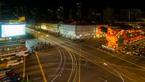Time lapse of long exposure auto light trails and Chinese New Year of the Rooster decorations in Chinatown Singapore uhd stock video footage