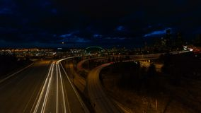 Time Lapse of Long Exposure Freeway Traffic and Clouds Over Seattle WA UHD 4k. Ultra High Definition UHD 4k Time Lapse Movie of Long Exposure Freeway Traffic and stock footage