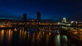 Time Lapse of Long Exposure Light Trails of Auto Traffic on Steel Bridge Across Willamette River at Blue Hour in Portland Oregon stock video footage