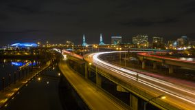 Time lapse of long exposure traffic light trails on freeways in downtown Portland Oregon at night  4k stock video