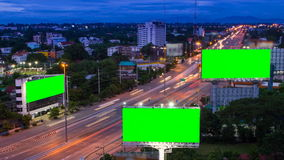 Time lapse long highway and three big billboard da. Y to night (green screen stock video