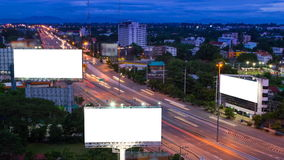 Time lapse long highway and three big billboard day to night. (white screen stock footage