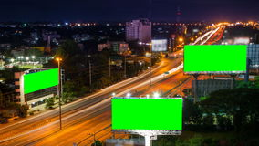 Time lapse long highway and three big billboard (g. Time lapse long highway and three big billboard in night time (green screen stock video footage