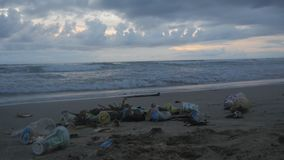Time-lapse of a lot of trash and plastic wastes on ocean beach after the storm. Kuta, Bali, Indonesia. Trash and plastic wastes on ocean beach after the storm stock video