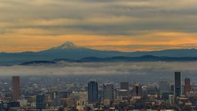 Time lapse of low clouds and fog over downtown Portland Oregon and mt. hood at sunrise 4k stock footage