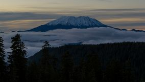 Time lapse of low fog over mount st. helens in Washington state at sunset 4k stock video