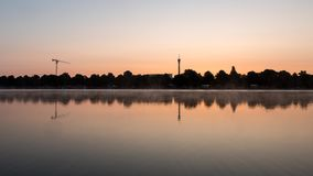Time lapse of Maschsee park in Hannover, Germany. Beautiful time lapse shot of mist floating across the huge artificial lake Maschsee in Hannover, Germany stock video footage