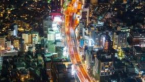Time lapse of Metropolitan Expressway no.3 Shibuya Line and city at night in Tokyo, Japan stock video