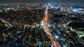 Time lapse of Metropolitan Expressway no.3 Shibuya Line and city at night in Tokyo, Japan stock video footage