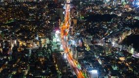 Time lapse of Metropolitan Expressway no.3 Shibuya Line and city at night in Tokyo, Japan stock footage