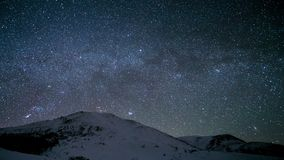 Time-lapse. Milky Way above the snowy peaks of the Carpathian Mountains stock video footage