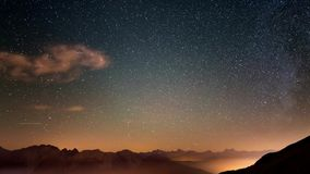Time Lapse of the Milky way and the starry sky with clouds over the Alps and the majestic Massif des Ecrins, France. Bardonecchia stock video footage