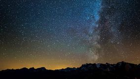 Time Lapse of the Milky way and the starry sky rotating over the French Alps and the majestic Massif des Ecrins. Sliding version. stock video
