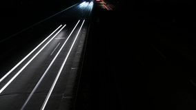 Time lapse of motion blurred head and tail lights - highway. High-angle view stock video footage