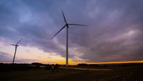 Time lapse motion of Wind Turbine in wind farm on sunset. stock footage