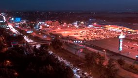 Timelapse. Fast traffic in the parking lot next to the street Malinovsky in the city of Rostov on Don. View from the roof of a sky