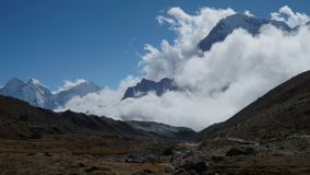 Movement of clouds against the background of the Himalayan mountains. Time lapse. Movement of clouds against the background of the Himalayan mountains. Track to stock footage