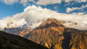 Time lapse. The movement of clouds near the majestic Mount Kangtega. Himalayas. Sagarmatha National Park, Nepal. Mount Kangtega and moving clouds. Track to the stock footage