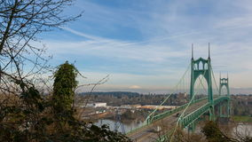 Time Lapse Movie of Auto Traffic and Moving Clouds Across Gothic Cathedral Like St. Johns Bridge along Willamette River 1080p stock video footage