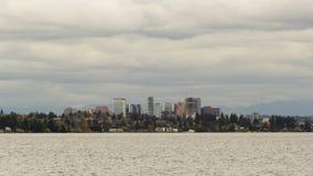 Time lapse movie of clouds over city skyline of Bellevue Washington along Lake Washington 4k uhd stock footage