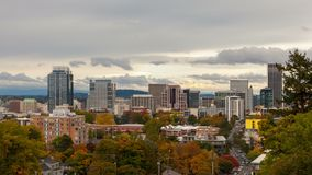 Time lapse of clouds over Portland OR urban downtown scene in fall season 4k uhd. Time lapse movie of clouds and sky over Portland Oregon downtown cityscape and stock video footage