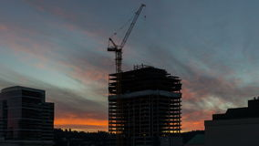 Time Lapse Movie of Colorful Fiery Sunset Over New Building Construction Site in Downtown Portland Oregon 1080p stock video