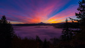 Time Lapse Movie of Colorful Sunrise with Snow Covered Mount Hood and Blanket of Low Lying Rolling Fog from Jonsrud Viewpoint stock video