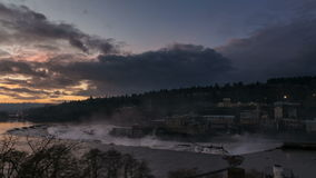 Time-lapse movie of Colorful Sunset with Dramatic Cloud Movement over Willamette Falls in Oregon 1080p stock video footage
