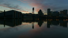 Time Lapse Movie of Colorful Sunset Over Downtown Skyline of Portland Oregon with Water Reflection and Hawthorne Bridge 1080p stock video