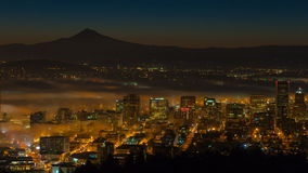 Time Lapse Movie of Early Morning Sunrise and Dense Rolling Fog Over Downtown Cityscape of Portland Oregon with Mount Hood 1080p stock video