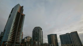 Time Lapse Movie of Fast Moving Gray Clouds Over Downtown Highrise Condominiums in Portland Oregon on a Stormy Winter Day 1080p stock footage