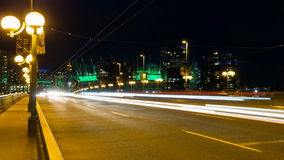 Time Lapse Movie of Long Exposure Fast Moving Traffic Light Trails on Cambie Bridge in Downtown Vancouver BC Canada at Blue Hour stock footage